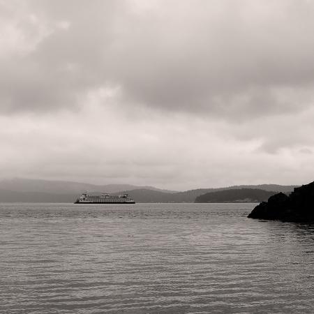 Washington State Ferry as seen from a cove on San Juan Island | Washington