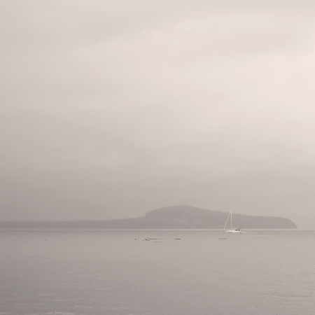 Lone boat in the drizzle